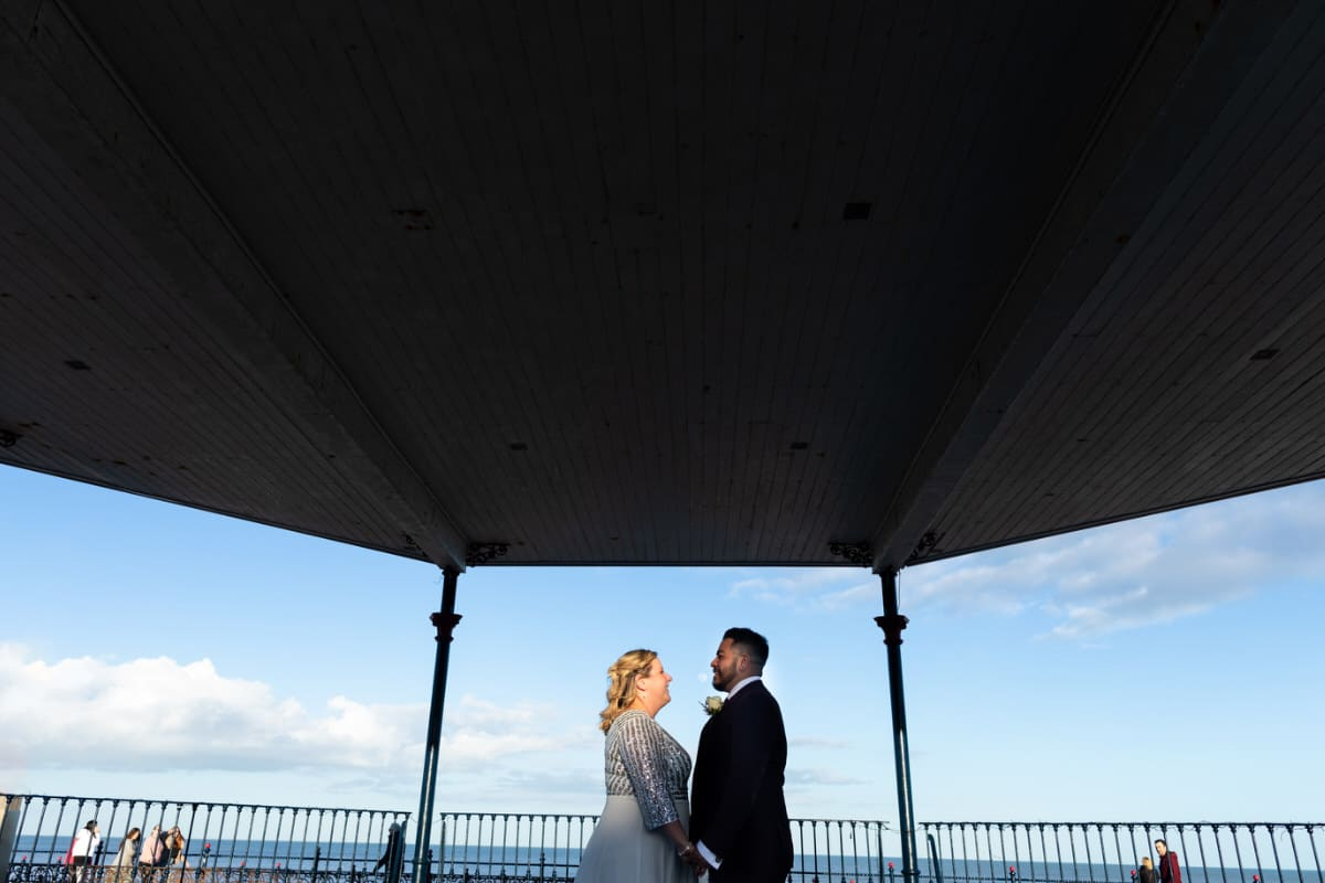 bride and groom on bray bandstand for their wedding photographs