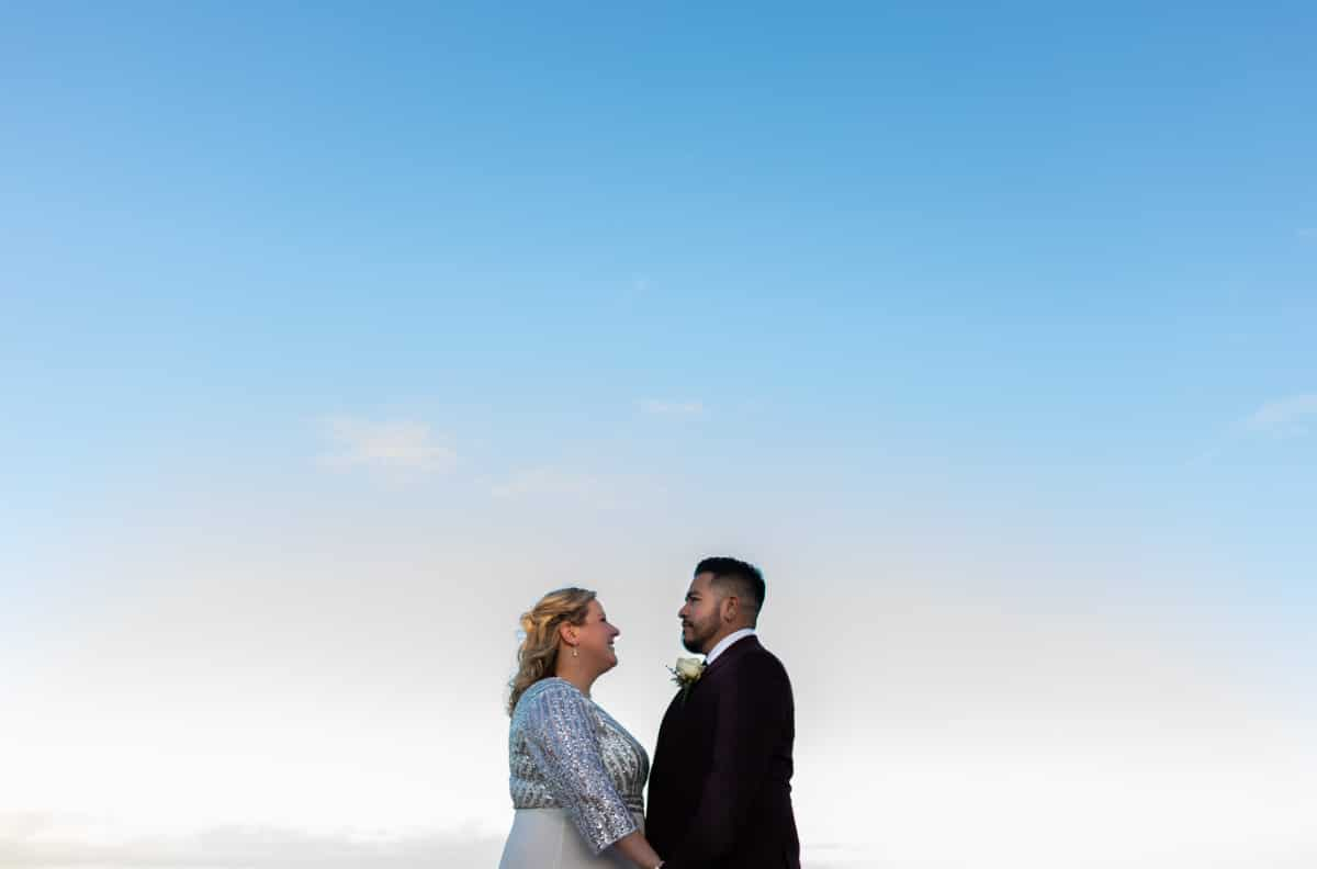 bride and groom on bray beach for their wedding photographs