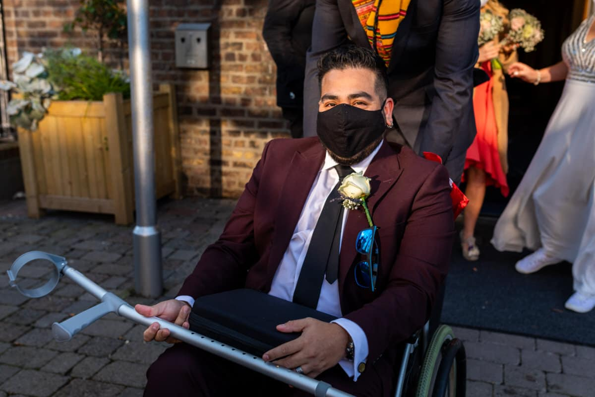 groom in wheelchair on wedding day