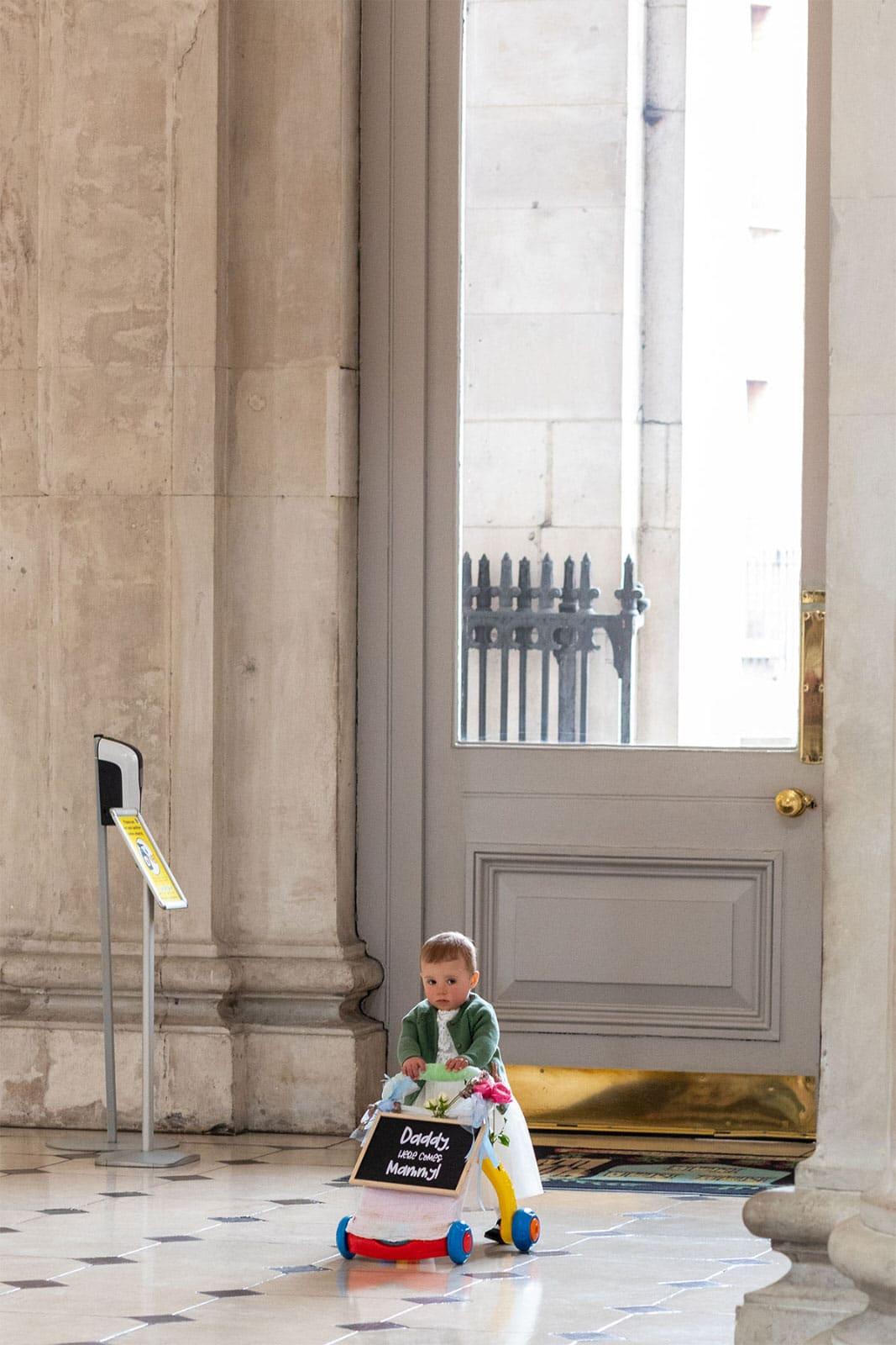 Flower girl walking down the aisle Dublin City Hall Wedding